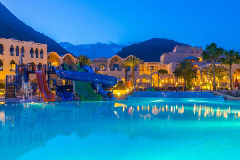 The pool and Aqua Park slides at El Wekala Aqua Park Resort at night