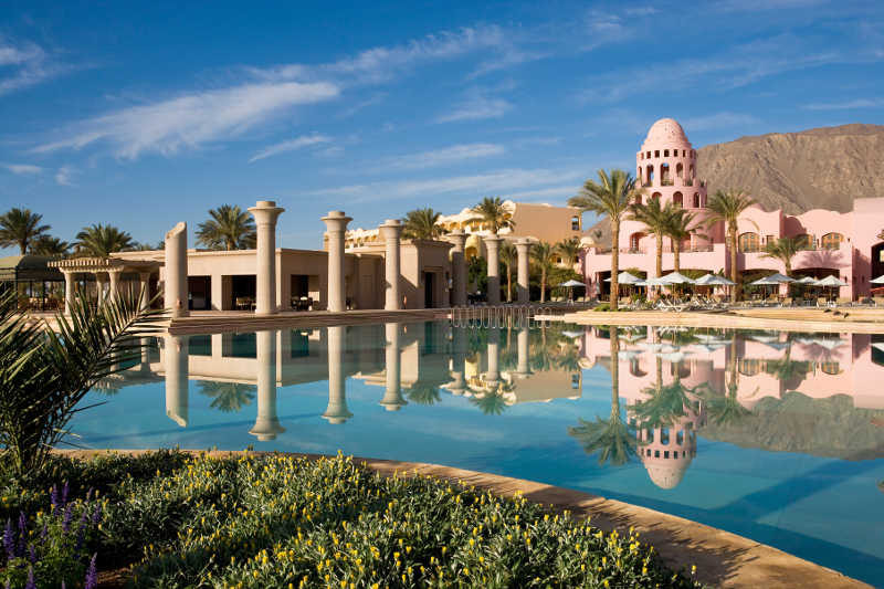 An overview of Mosaique Beach Resort with a view to the pool