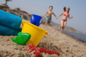 Kids play at the beach of Mosaique hotel in Taba Heights Sinai