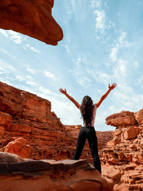 A girl enjoys her time in Red Canyon at the heart of Red Sea Mountains in Taba Egypt