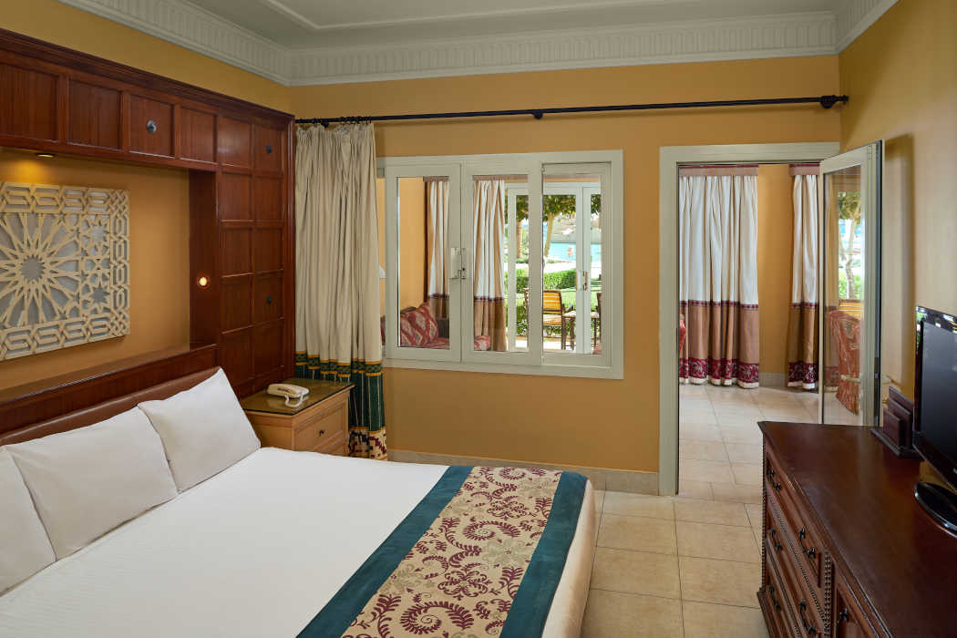 The family Suite at Mosaique Beach Resort with a kingbed room and a seating area connected with a door