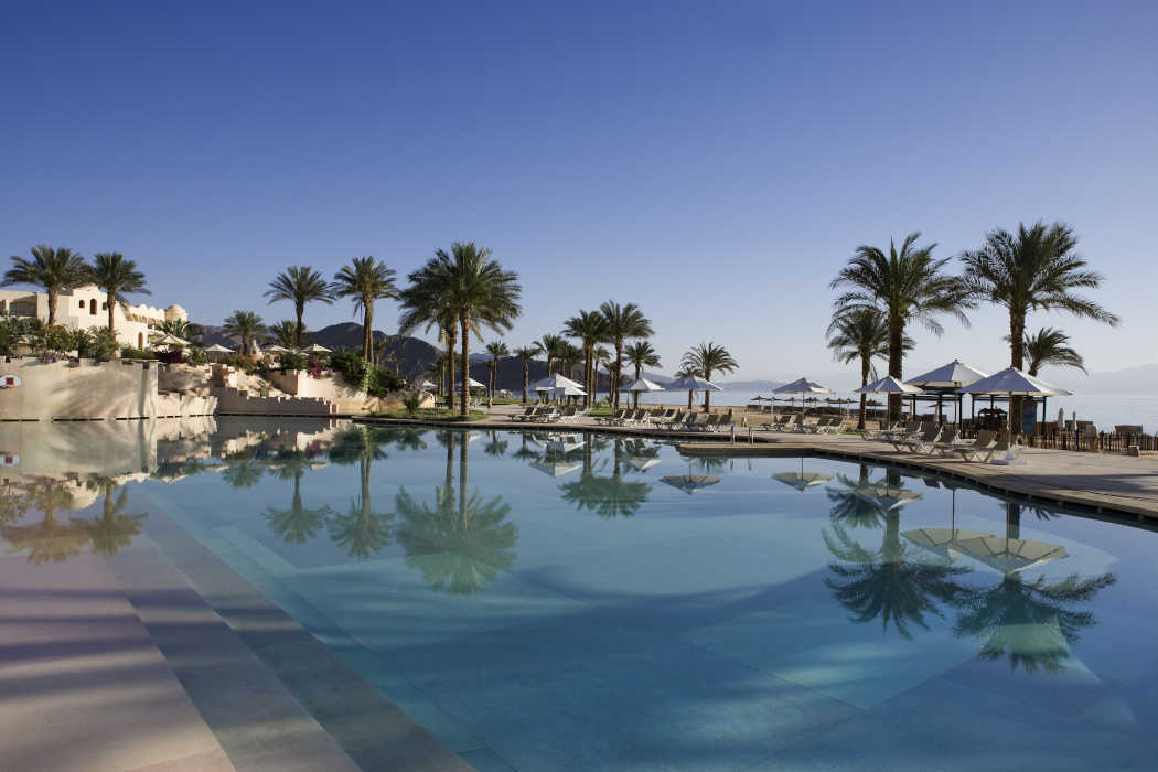 The swimming pool of Mosaique Hotel overlooks the Red Sea
