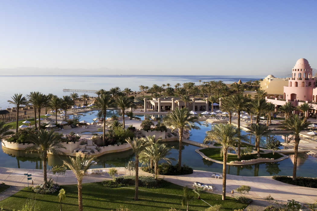 The hotel top view of Mosaique beach resort shows the pools, sea shore and gardens in Taba Heights Resort