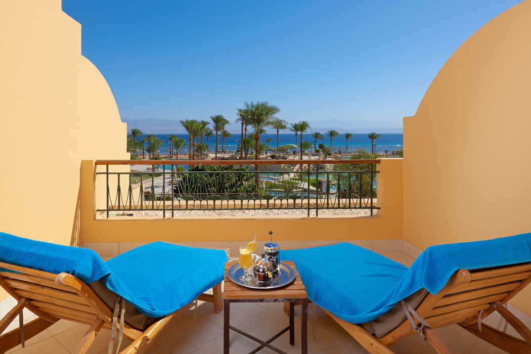 2 sunbeds at the room's balcony at Mosaique Beach Resort with the view of Red Sea